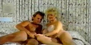Vintage blonde Lotta Topp fucks on bed