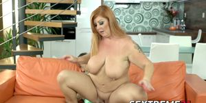 Busty redhead granny pleasures her young lover like a pro