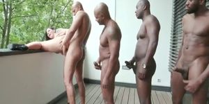 Busty bitch comes to receive black cocks in all her holes