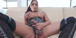 Busty inked latina tranny in leather lingerie masturbating
