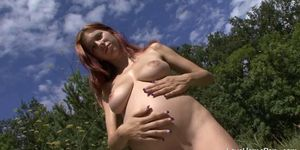 Big tits pregnant chick is outside and riding