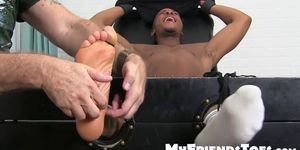 Ebony jock Trent King tied up and tickled incessantly