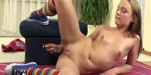 Teen sweetheart plays with her bald pussy