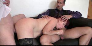 Redhead business lady swallows two big cocks