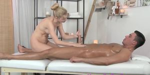Classy tattooed masseuse spreading her legs