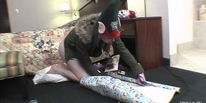 tiny midget wrapping christmas presents so tiny young and even with braces