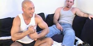 Muscular hunk enjoys a foot licking massage from his buddy