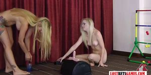 Two blondes play a strip game of throw the balls