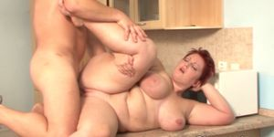 Redhead BBW tit fucked and plowed in kitchen