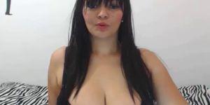 Busty milf reveals huge tits on webcam show