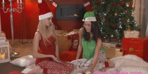 Lesbea Xmas girlfriend gets first time fuck with a strap on