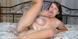Animee masturbates with a rainbow dildo in bed