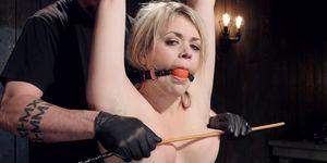 PAWG blonde caned in device bondage