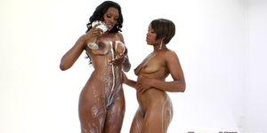Busty ebony MILFs enjoy milk enema fetish