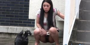 Embarrassed asian peeing