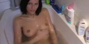 Teenage girl takes bath and gives head