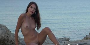 NUDE FEMJOY - Nubile Katrine Pirs strips naked outdoor on the beach