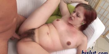Redhead chick rides a stiff dick