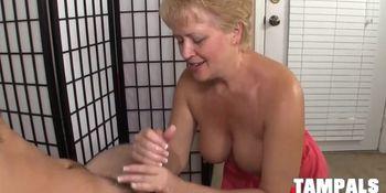Lusty Mature Blonde Giving a Hand-job