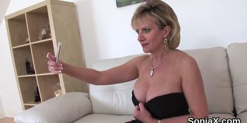 Cheating English milf lady Sonia shows off her big jugs