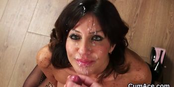 Slutty looker gets jizz shot on her face eating all the cream