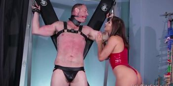 Lusty domina is spanking her tied slave