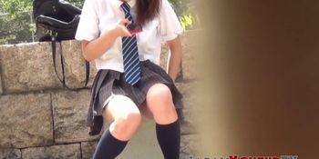Cute Japanese schoolgirl taped up skirt outdoors