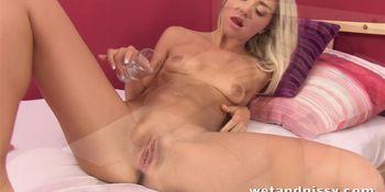 Gorgeous blonde pees her panties in bed