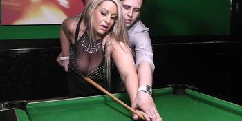 Big tits blonde spreads her legs on the table