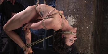 BDSM sub tied up and punished with bastinado