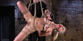 Restrained BDSM beauty gets toyed by maledom