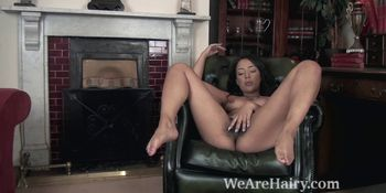 Kayla Louise strips nude on her armchair